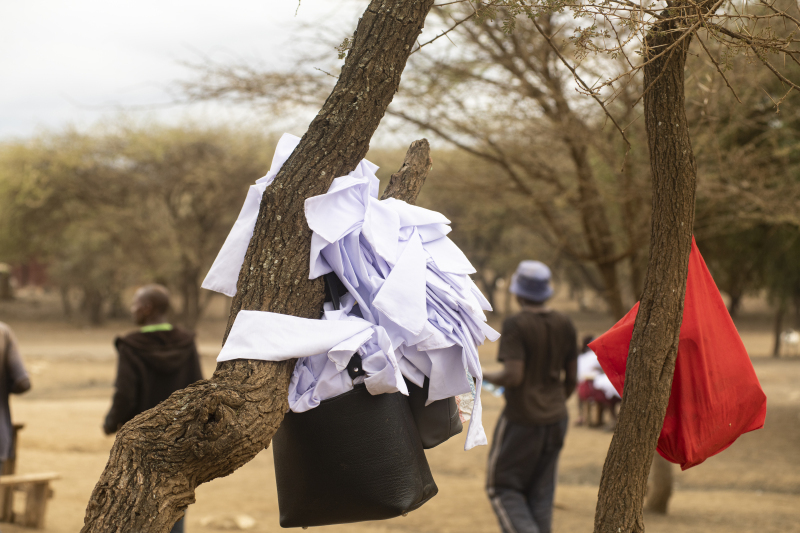 """At the Alternative Rite of Passage (ARP) ceremony, Maasai teens wear white """"purity"""" scarves to signify they are mature enough for marriage, but only after she completes her education. Before ARP, when girls underwent female genital mutilation, the white scarves indicated that the girl was ready for marriage."""